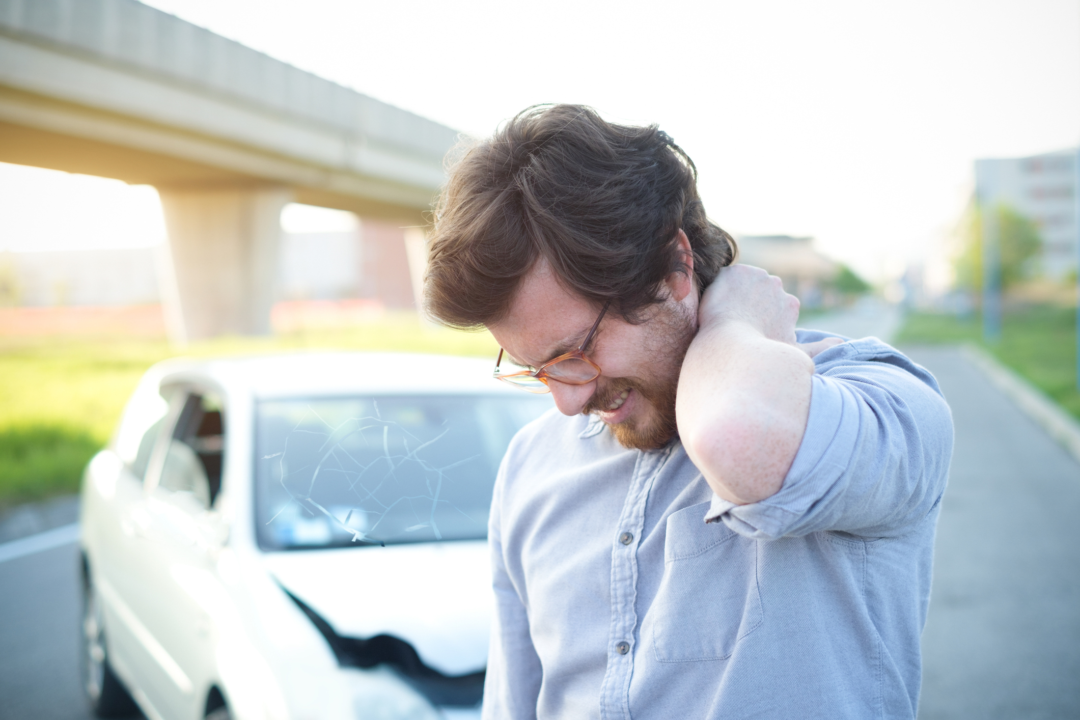 Man feeling pain to the neck after car crash
