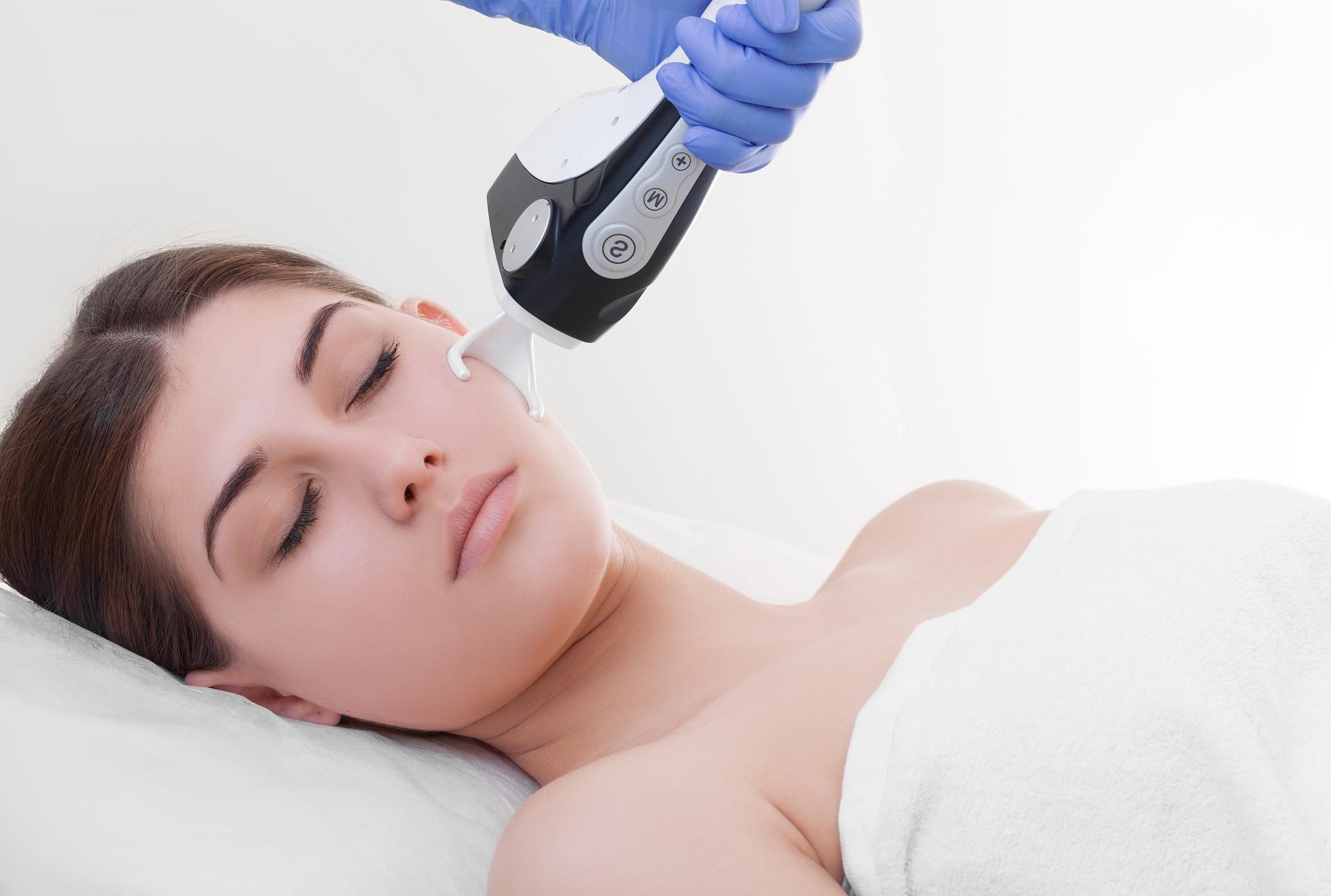 woman making laser skin resurfacing in aesthetic medicine.